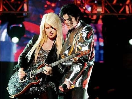 "Austrian guitarist extraordinaire Orianthi was hand-picked by Michael Jackson to handle live on-stage versions of famous guitar riffs in his songs such as ""Beat It"" and ""Black or White."""